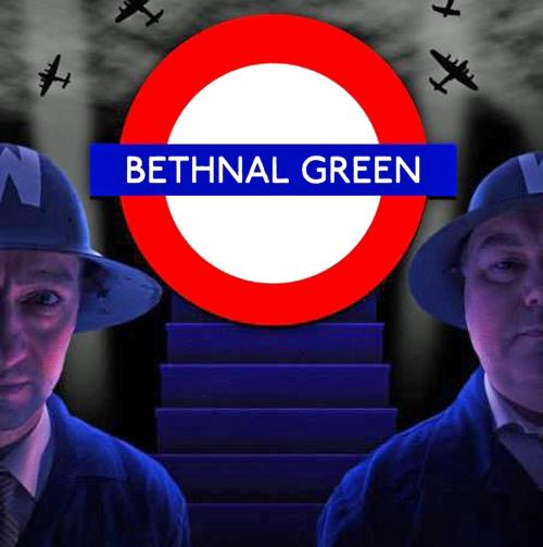 Underground roundel flanked by actors dressed in ARP uniforms. Staircase in the background.