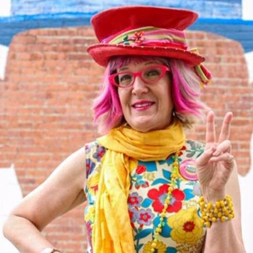 Princess Wow sharing a peace sign to bring more smiles in her colorful regalia. Photo: Elite Ziegelman